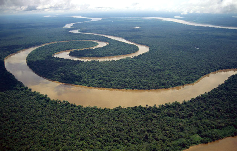 ca. 1998, Peru --- An aerial view of the Tigre River, an Amazon River tributary, that meanders through the Peruvian rainforest. --- Image by © Layne Kennedy/CORBIS