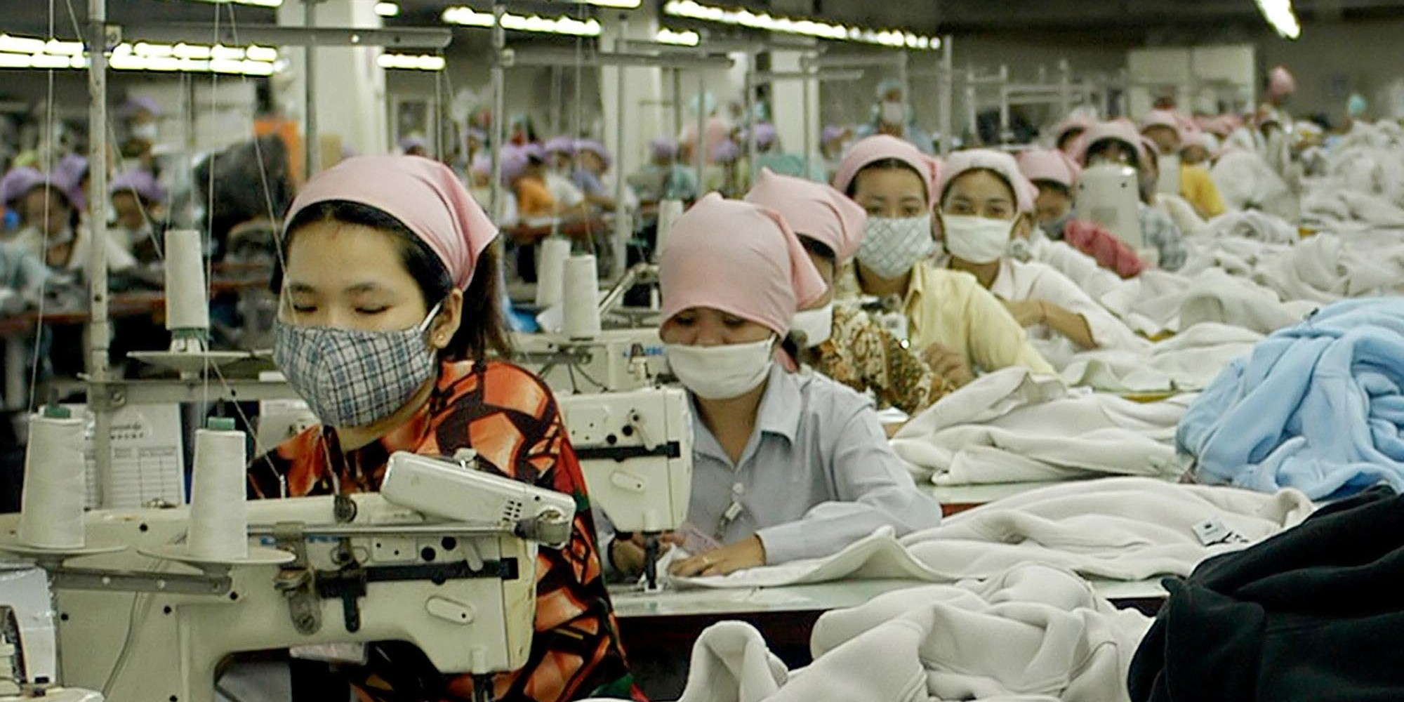 Cambodian garment factory workers toil at the W&D garment factory, just southeast of Phnom Penh, April 28, 2004. Cambodia's garment industry has grown from 49 factories in 1996 to more than 200 factories today, employing 240,000 people. But as the end approaches for a special deal between the United States and Cambodia linking labor rights to trade quotas the workers are worried for their futures. (AP Photo/Isabelle Lesser)